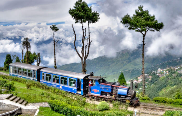 Toy train passes through the foothills of Darjeeling