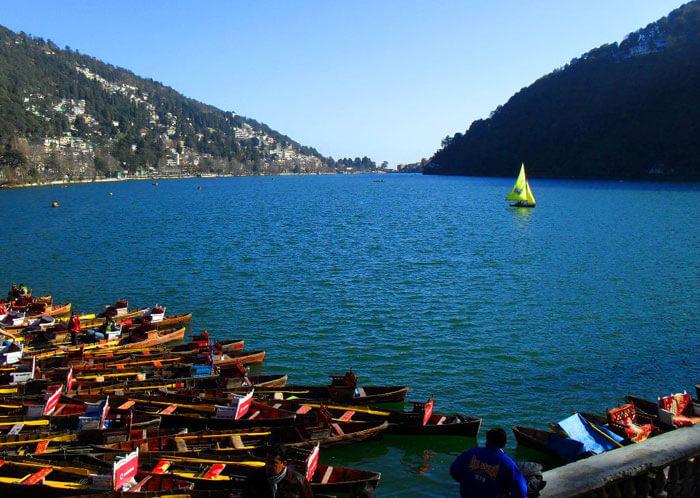 Boats line up at the shore of Naini Lake at Nainital