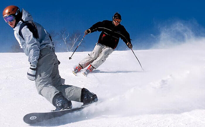 People try skiing and snowboarding at Pahalgam
