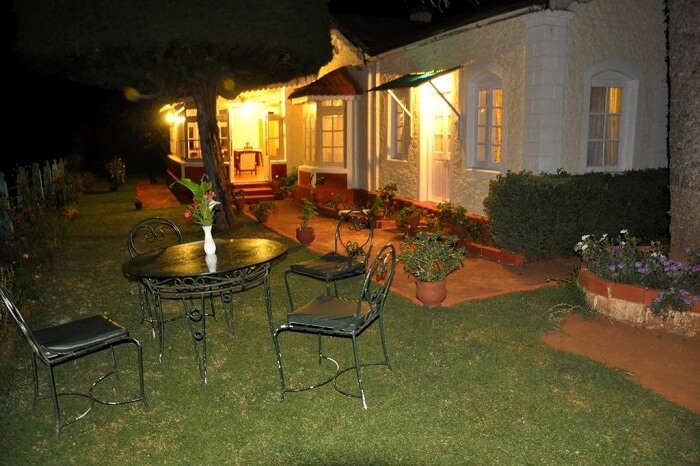 A nightshot of the garden at the Wyoming Heritage Colonial Bungalow in Ooty