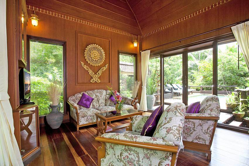 inside a beautiful bedroom of Orchard Paradise