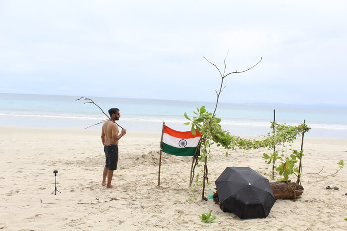 set up a camp on beach with Indian flag