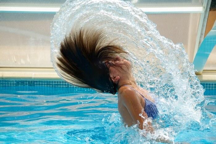 Girl bathing in pool