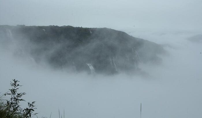 seven sisters falls, shrouded in mist
